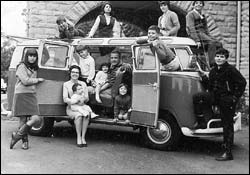 Family in old VW Microbus