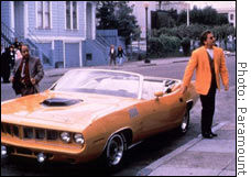 This 1970 Plymouth 'Cuda -- show here with Don Johnson (right) as Nash Bridges and Cheech Marin as Joe Dominguez -- sold for $148,000.