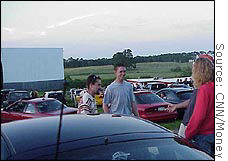 Patrons at Warwick, N.Y., drive-in greet friends before the recent Friday night show.