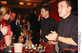Whiskey connoisseurs enjoy a tasting at the Johnnie Walker table at WhiskyFest, 2003.
