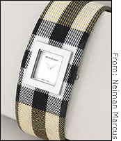 Shoppers are picking up pricey gifts like this $295 Burberry signature check cuff.