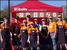Kevin Jackson (second from right) with his family and employees.