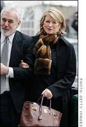 One hand on her lawyer, the other on her Birkin
