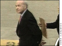 Former Enron CEO Kenneth Lay being led in handcuffs to the U.S. courthouse in Houston Thursday.