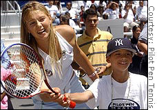Sharapova giving a tennis clinic before a recent tournament.