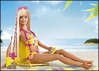 Barbie split from long-time beau, Ken, this year. Cali Barbie now sports a deep tan and a new Australian pal, Blaine.