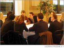 Groups of 10 sat around tables to engage in