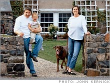 Richard and Day Newburg, daughter Maia and Lincoln the chocolate Lab.