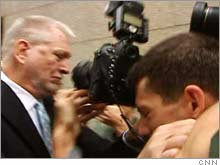 Ebbers, on his way to be sentenced Wednesday morning, pushed a photographer out of his way.