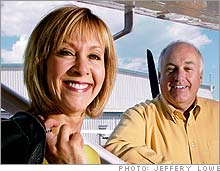 Early retirees: Pilot Keith Bruce and designer Sandy Peletier saved enough to retire and travel the world.