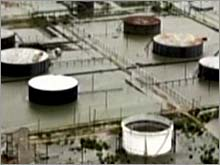 Oil tanks in Port Arthur, Texas, surrounded by flood waters from Hurricane Rita.