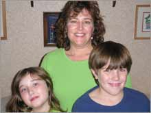 Clare Cheesman with two of her three kids, Kelly, 9 and Brian, 11.