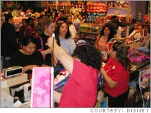 Customers checking out at The Disney Store in Glendale, Calif.