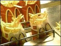 McDonald's has upped its estimates for the trans fat in its french fries by one-third, according to a published report.
