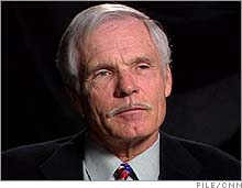 In an interview, outgoing Time Warner board member Ted Turner voiced both support and criticism of Time Warner policies.