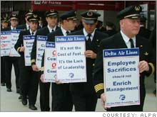 Pilots at Delta Air Lines, shown here on an informational picket line, could be on strike in a little more than a week, according to its union.