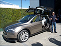 Tesla unveils its Model X SUV with 'falcon wings'