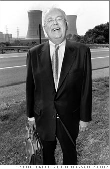 Exelon CEO John Rowe, standing in front of the company's Three Mile Island nuclear energy plant.