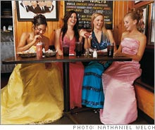 Prom gown designer and U of Iowa junior Megan Wettach (second from left) already has customers.