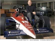 Rahal in the Wexford, Pa. showroom, where he sells Jaguars, Land Rovers and Volvos, with a model of a Rahal Letterman Indy car.